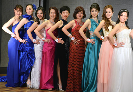 Mrs Malaysia Petite World 2015 contestants on stage in their evening wear
