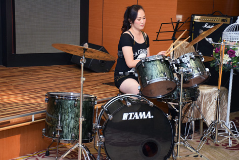 Sherry Phua plays the drums