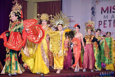 Contestants parading in national costumes wear