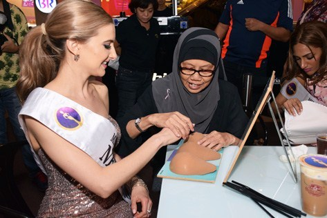 BCWA nurse Sister Mariyana shows Miss Cosmopolitan World 2015 New Zealand Rachel Adele the proper way to do self breast examination.