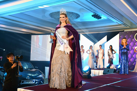 Newly crowned Miss Cosmopolitan World 2015 Rachel Harradence, from New Zealand, doing her victory walk