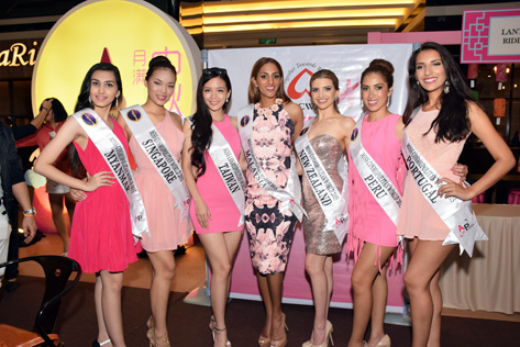 Some of the Miss Cosmopolitan World 2015 finalists pose at high tea charity event