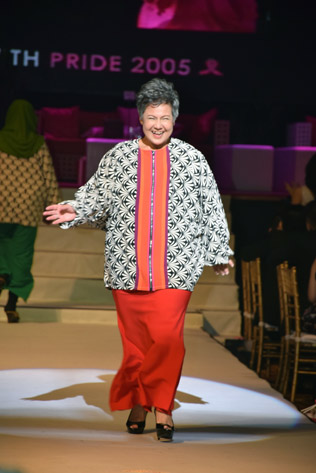 Breast cancer survivor Rene Aziz Ahmad takes it all in her stride to the catwalk at Walk With Pride chairity dinner and runway show