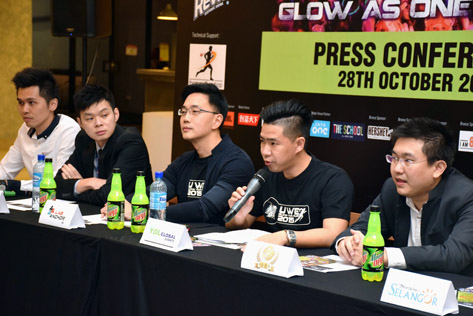Derek Lim speaking at the press conference to launch U We Glow Fun Run 2015