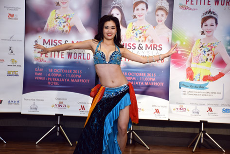 Miss Malaysia Petite World 2015 Audrey Lee performs a belly dance