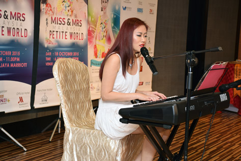 Multi-talented Miss Malaysia Petite World 2015 second runner-up Excella Chong sings her self-composed song Broken Heart