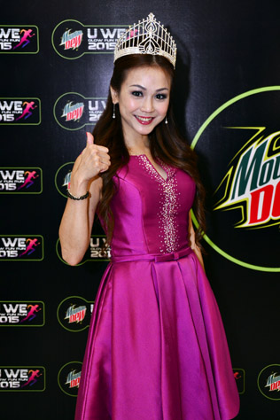 Mrs Chinatown World Ambassador 2015 Catherine Cheah gives the thumbs up for U We Glow Fun Run.