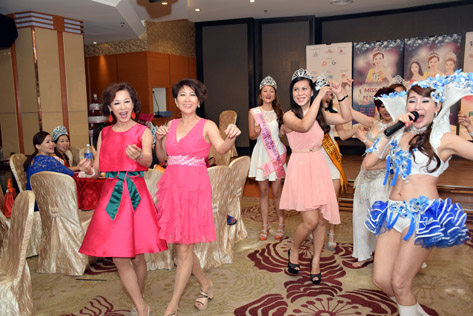 The energetic host Madam Lim in a dance-and-sing along entertaining her Thank You lunch guests