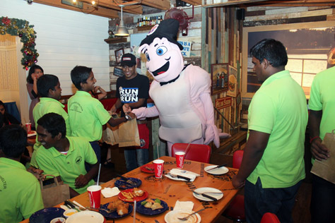 All smiles for the Agathians Shelter boys as they meet with the Bubba Gump Shrimp mascot during dinner at Bubba Gump Shrimp Co.