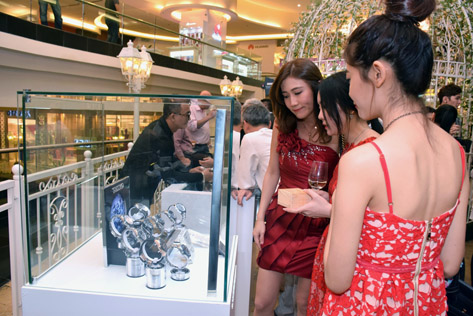 Guests appreciating the timepieces