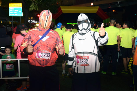 Iron Man and Storm Trooper give the thumbs up for Costume Nite Run
