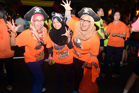 Participants of Costume Nite Run enjoying the fun
