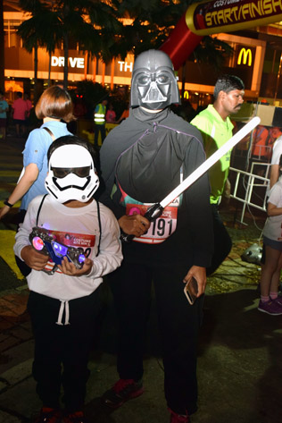 Runners dressed as Darth Vader and Storm Trooper from Star Wars.
