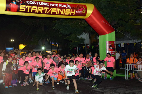 Runners of the New Year's Eve fun run kick starts the annual countdown party at MDCC