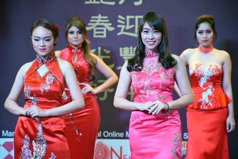 Models wearing colourful cheongsam or qipao, strutted down the runway during the X Brand Ambassadors fashion show held in conjunction with the Chinese New Year celebrations
