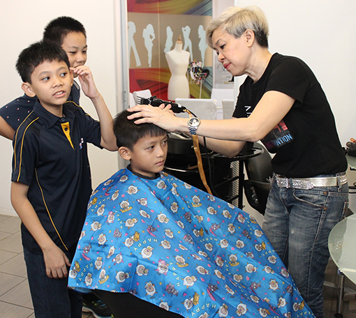 The children of Shelter Home getting their stylish haircut at the S'Pro Hairdressing Salon.