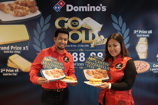 Shamsul Amree, General Manager, Operations, Domino's Pizza Malaysia and Singapore (left) together with Linda Hassan, Deputy General Manager, Marketing, Domino's Pizza Malaysia and Singapore (right) at the launch of Domino's New Mozzarella Cheese Stix and Go for Gold contest.