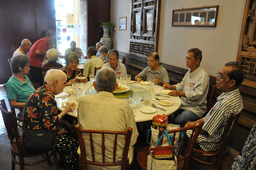 The senior citizens of Sungai Way Old Folks Home having a hearty lunch at Ah Tuan Ee, a Nyonya-style restaurant.