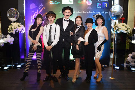 Wilson Tan in Charlie Chaplin costume and his party guests