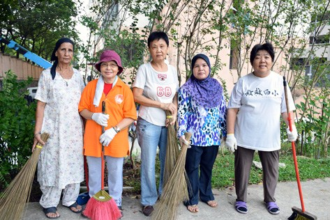 Damansara Bistari flats residents with brooms getting ready for gotong royong clean up