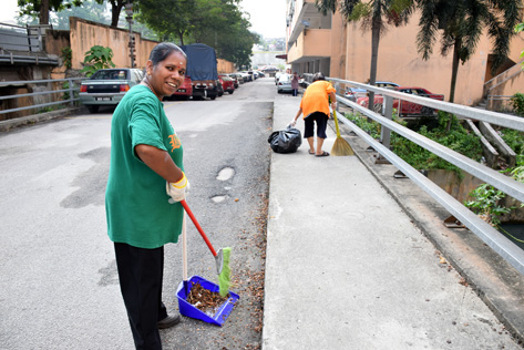 Flat resident Devi Shamugam is happy to participate in gotong royong clean-up of the surrounding area. She hopes people are more responsible when throwing their unwanted rubbish to help keep their surroundings clean.