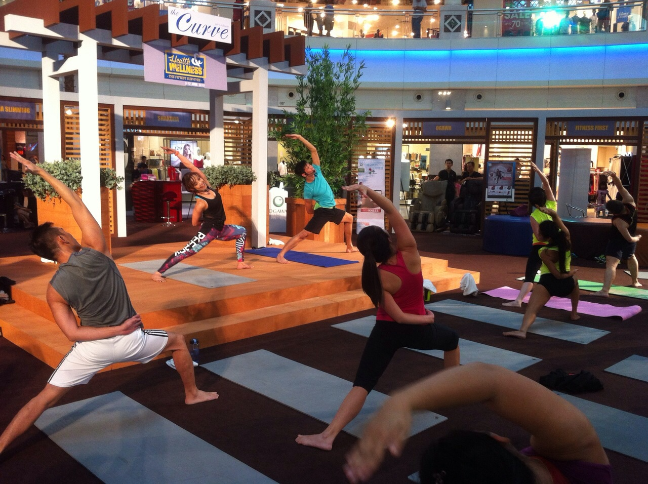 Fitness First instructors conducting a Body Balance class at the Curve's Centre Court.