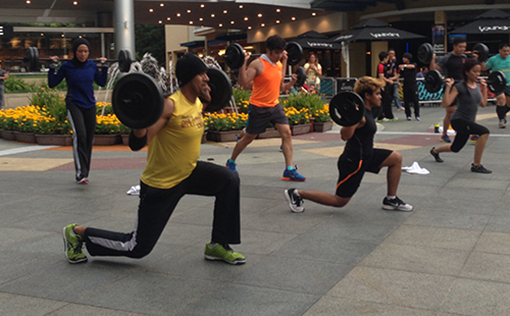 Participants working up a sweat with weights at the Piazza
