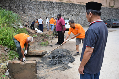 Residents also cleared the drains around the flats compound