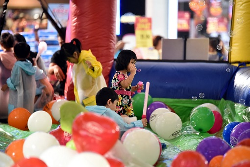 Children playing with bubbles at the unique children's bubbly area