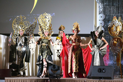 Contestants parade in their national costumes