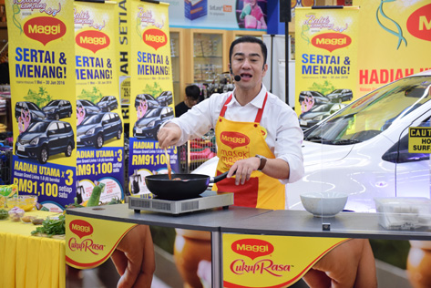Local celebrity Chef Zam holds a cooking demonstration during the Balik Kampung With Maggi Ramadan contest launch