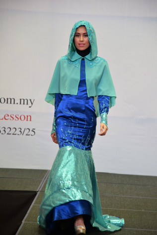 A model presents a Muslimah fashion design at IFTC Young Star Fashion Runway Show at Paradigm Mall, PJ