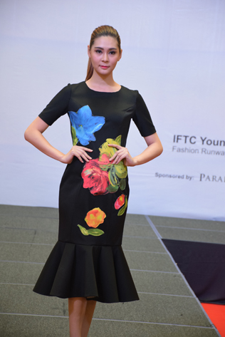 A model strutted her stuff on a catwalk wearing creations by IFTC aspiring designers