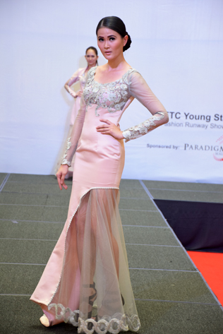 A model wearing a dress designed by Siti Aminah Binti Sharuddin