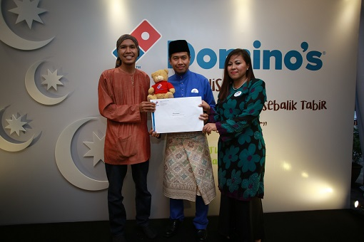 Domino's Pizza Malaysia and Singapore presenting the contribution to Ahmad Faizal to be given to a charity of his choice.