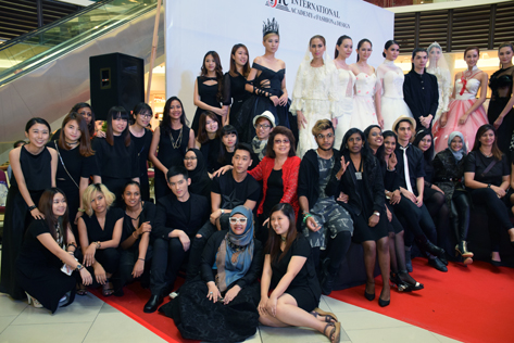 IFTC principal and founder Annie Wong (centre, in red blouse) pose for a photograph with all her students and models after the runway show