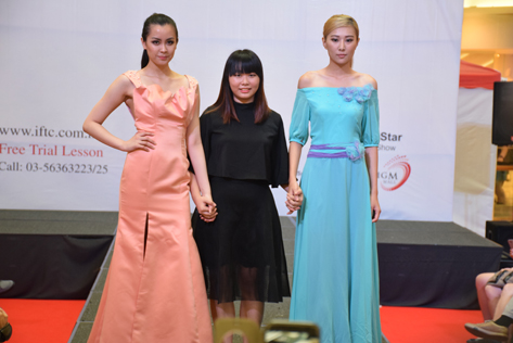 Models wear creations during the presentation of IFTC Young Star Fashion Runway Show