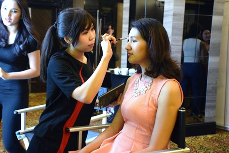 Candidates get their face touched-up by Sephora, the make-up sponsor, before called in for audition