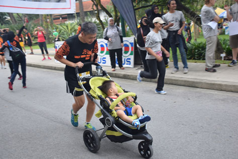 Dad Runs and Pushes Baby Boy in Stroller