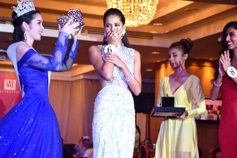 Tatiana Kumar reacts as she is announced the winner of Miss Malaysia World 2016 pageant