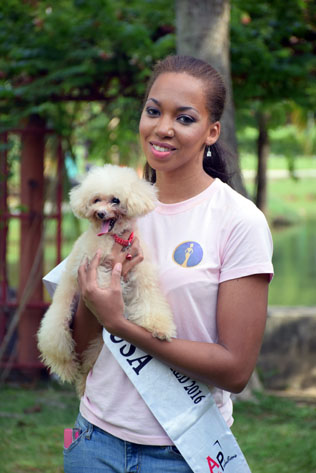 Miss Cosmopolitan World USA 2016 - Kiana Harris holding a toy poodle
