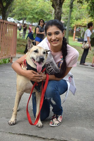 Miss Cosmopolitan World Bangladesh 2016 - Zohra Etisha with 12-year-old mongrel named Kuning, rescued from Pulau Selat Kering, off Pulau Ketam