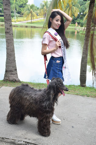 Miss Cosmopolitan World China - Beijing 2016 Li Yu Yanga with a 10-year-old female Afghan Hound