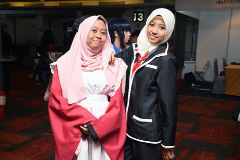 Tama (left) of Gugure Kokkuri-san and Shiro (right) of K anime