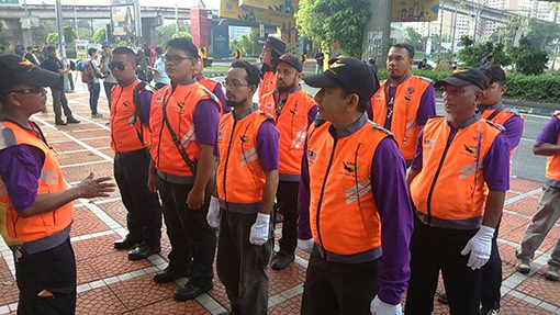 a surge of purple clad volunteers were in charge for the safety and security of the Bersih 5.0 rally